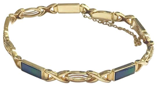 Preload https://img-static.tradesy.com/item/25946599/estate-collection-14-karat-yellow-gold-and-opal-bracelet-0-2-540-540.jpg