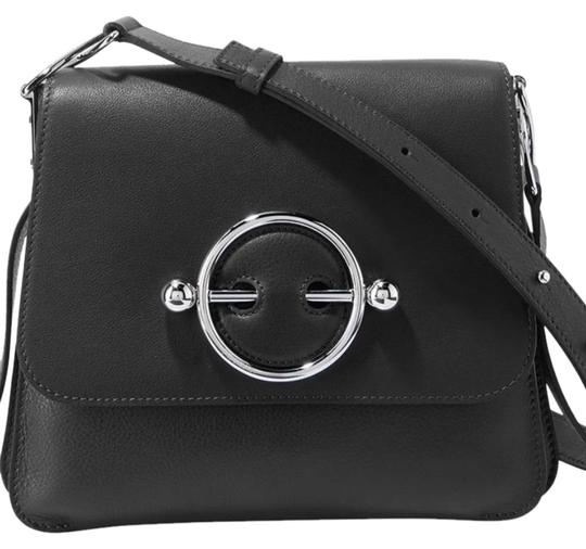 Preload https://img-static.tradesy.com/item/25951272/jwanderson-w-new-with-disc-black-leather-cross-body-bag-0-2-540-540.jpg