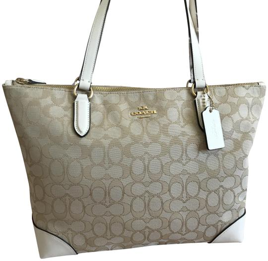 Preload https://img-static.tradesy.com/item/25951653/coach-signature-chalk-khaki-white-jacquard-tote-0-2-540-540.jpg