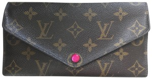 Louis Vuitton Wristlet in dark brown patterned with pink interior