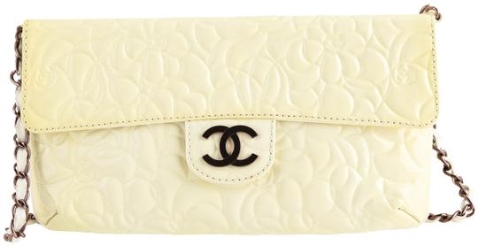 Preload https://img-static.tradesy.com/item/25957477/chanel-classic-flap-camellia-small-yellow-patent-leather-shoulder-bag-0-1-540-540.jpg
