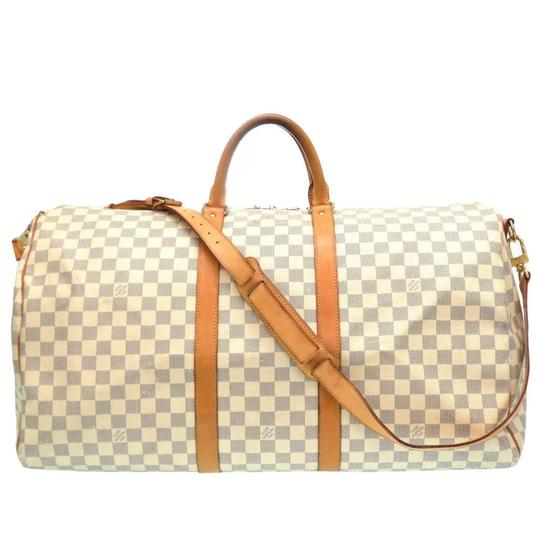 Preload https://img-static.tradesy.com/item/25957580/louis-vuitton-keepall-bandouliere-55-damier-azur-white-coated-canvas-weekendtravel-bag-0-0-540-540.jpg
