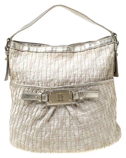 Preload https://img-static.tradesy.com/item/25958009/givenchy-shimmering-and-leather-trim-beige-canvas-hobo-bag-0-1-540-540.jpg