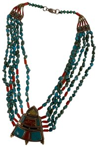 Navajo Turquoise And Coral vintage handmade Navajo silver, turquoise, and coral necklace with lobster clasp.