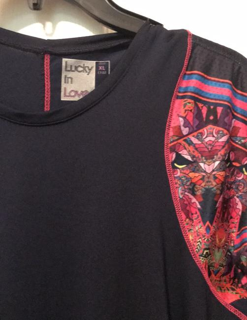 Lucky In Love Ladies tennis top. Image 1