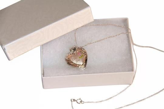 Preload https://img-static.tradesy.com/item/25965734/lovely-sterling-silver-i-love-you-locket-and-chain-necklace-0-4-540-540.jpg