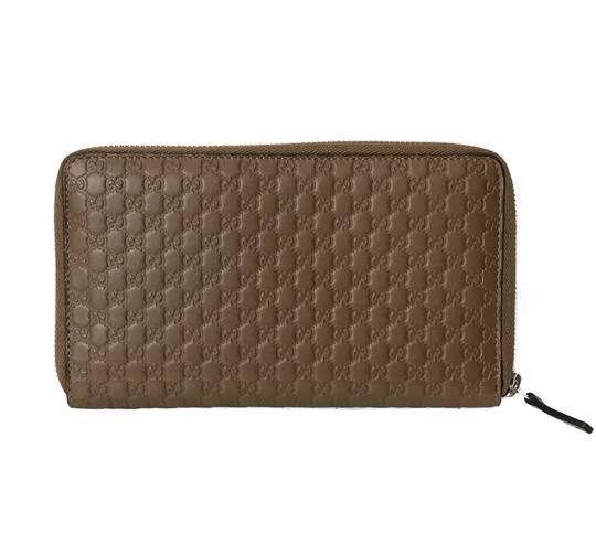 Preload https://img-static.tradesy.com/item/25965759/gucci-brown-new-leather-microguccissima-zip-around-wallet-0-0-540-540.jpg