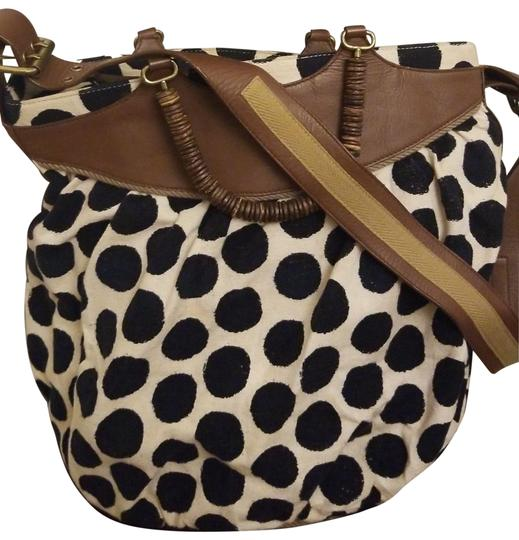 Preload https://img-static.tradesy.com/item/25965974/tocca-large-white-blue-and-brown-cotton-fabric-leather-hobo-bag-0-2-540-540.jpg