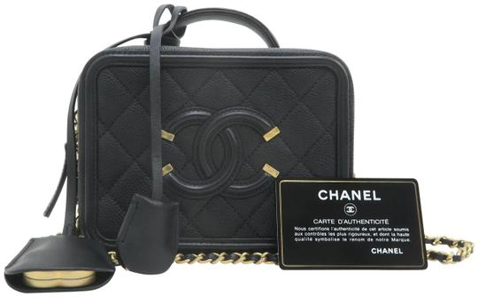 Preload https://img-static.tradesy.com/item/25974316/chanel-vanity-case-small-quilted-cc-filigree-black-caviar-satchel-0-2-540-540.jpg