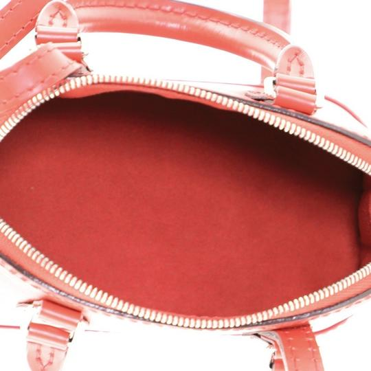 Louis Vuitton Alma Epi Leather Satchel in red Image 6