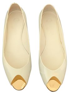 Chanel cream with gold trim Flats