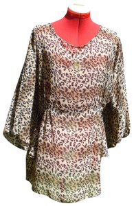 The Pyramid Collection Animal Print Batwing Sleeve Dolman Tunic
