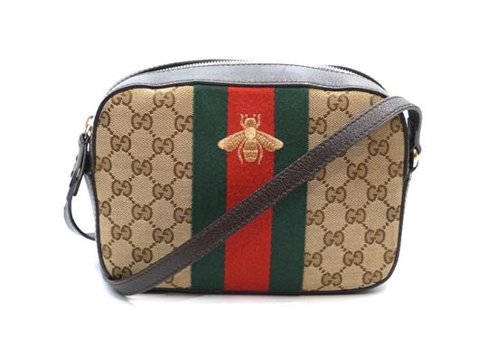 Preload https://img-static.tradesy.com/item/25990529/gucci-bee-web-monogram-gg-print-brown-canvas-cross-body-bag-0-1-540-540.jpg