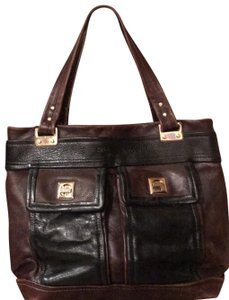 Kate Spade Tote in black and reddish brown leather with gold trim