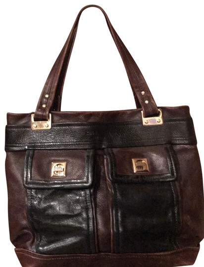 Preload https://img-static.tradesy.com/item/25994865/kate-spade-front-interior-pockets-black-and-reddish-brown-leather-with-gold-trim-tote-0-1-540-540.jpg