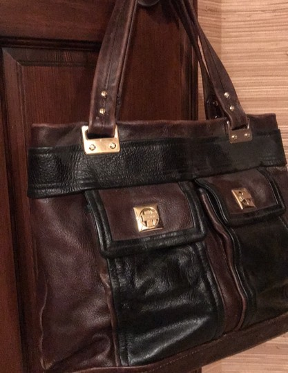 Kate Spade Tote in black and reddish brown leather with gold trim Image 1
