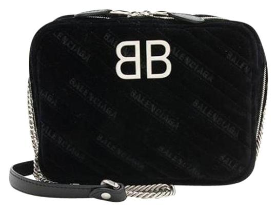Preload https://img-static.tradesy.com/item/25997498/balenciaga-reporter-xs-black-velvet-cross-body-bag-0-3-540-540.jpg