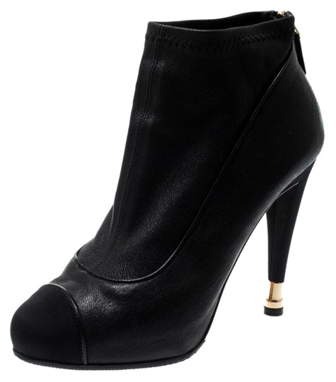 Preload https://img-static.tradesy.com/item/25998536/chanel-black-leather-and-fabric-cap-toe-cc-ankle-bootsbooties-size-eu-375-approx-us-75-narrow-aa-n-0-1-540-540.jpg