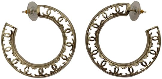 Preload https://img-static.tradesy.com/item/25998691/chanel-gold-cc-logo-round-cut-out-tone-classic-statement-hoop-earrings-0-4-540-540.jpg