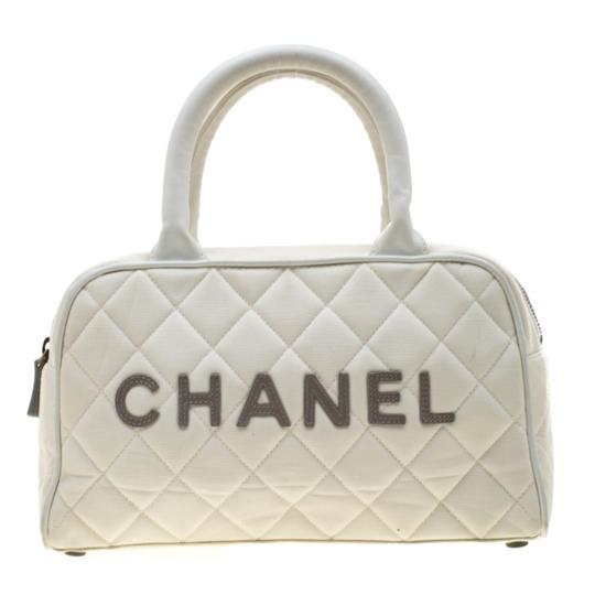Preload https://img-static.tradesy.com/item/25999097/chanel-boston-bag-quilted-and-leather-cc-white-canvas-satchel-0-0-540-540.jpg