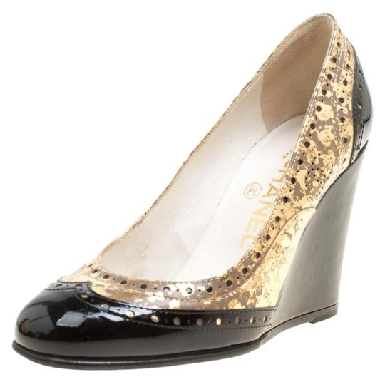 Preload https://img-static.tradesy.com/item/25999689/chanel-black-metallic-gold-and-patent-brogue-leather-wedge-pumps-size-eu-355-approx-us-55-regular-m-0-1-540-540.jpg