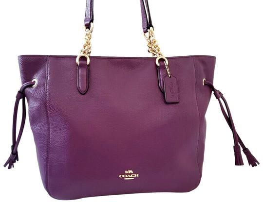 Preload https://img-static.tradesy.com/item/26000002/coach-shoulder-bag-new-classy-pebbled-chain-strap-business-purple-leather-tote-0-2-540-540.jpg