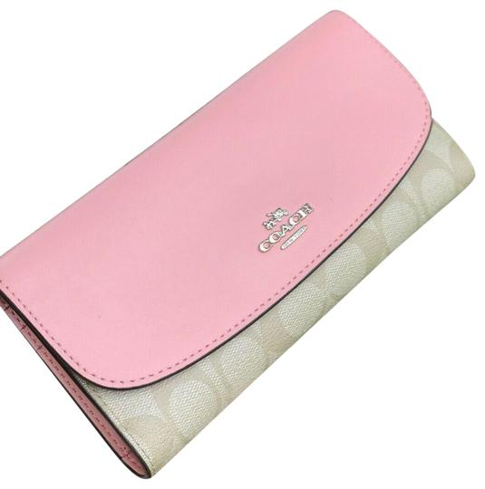 Preload https://img-static.tradesy.com/item/26000108/coach-blush-pink-pvc-and-leather-checkbook-in-light-khaki-wallet-0-2-540-540.jpg
