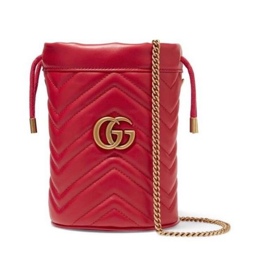 Preload https://img-static.tradesy.com/item/26000532/gucci-bucket-marmont-gg-quilted-leather-mini-red-cross-body-bag-0-0-540-540.jpg
