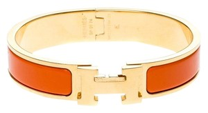 Hermès Clic Clac H Orange Enamel Gold Plated Narrow Bracelet PM