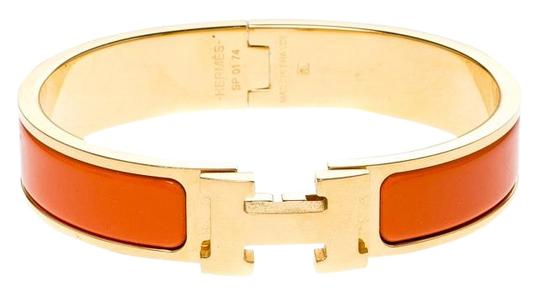 Preload https://img-static.tradesy.com/item/26001052/hermes-orange-clic-clac-enamel-gold-plated-narrow-bracelet-pm-0-2-540-540.jpg