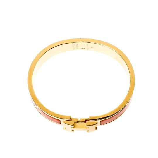 Hermès Clic Clac H Orange Enamel Gold Plated Narrow Bracelet PM Image 1