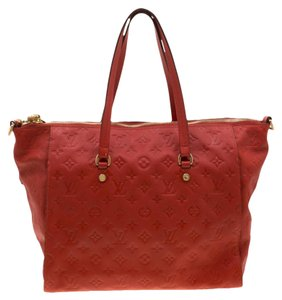 Louis Vuitton Leather Monogram Tote in Red