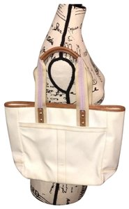 Coach Tote in off white and lavender lining