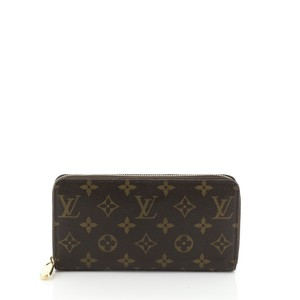 Louis Vuitton Zippy Wallet Monogram Wristlet in brown