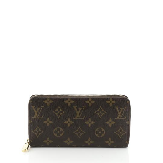 Louis Vuitton Zippy Wallet Monogram Wristlet in brown Image 0