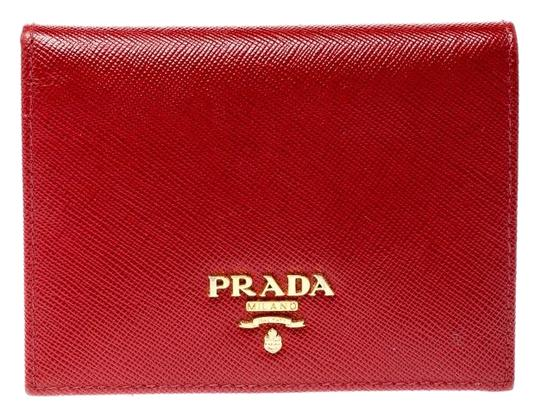 Preload https://img-static.tradesy.com/item/26008526/prada-red-lux-saffiano-leather-bifold-wallet-0-3-540-540.jpg