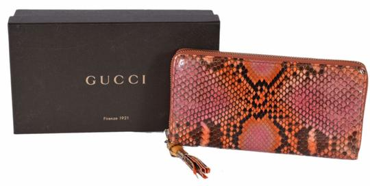Preload https://img-static.tradesy.com/item/26016168/gucci-multi-color-women-s-307984-orange-python-snakeskin-bamboo-zip-around-wallet-0-0-540-540.jpg
