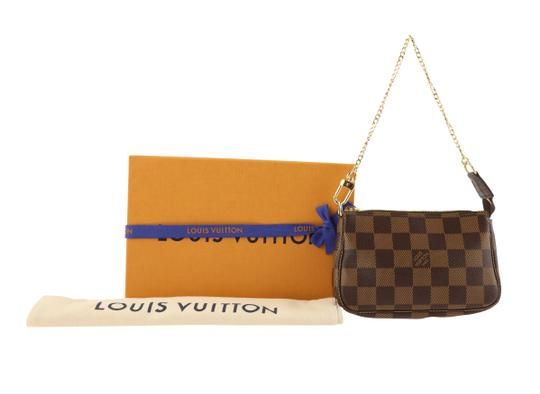 Louis Vuitton Damier Canvas Leather Gold Hardware Wristlet in Brown Image 11