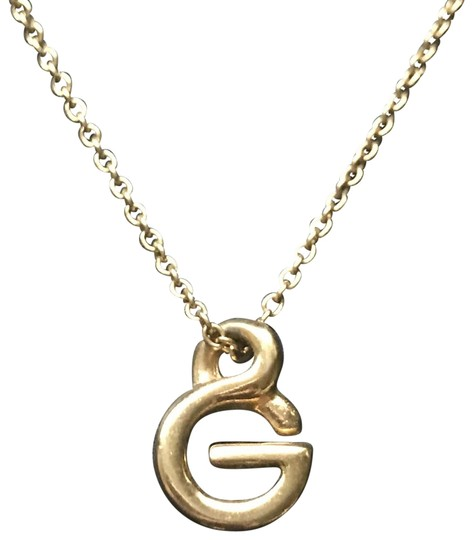 Preload https://img-static.tradesy.com/item/26021879/givenchy-gold-g-necklace-0-3-540-540.jpg