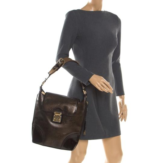 Louis Vuitton Monogram Leather Tote in Brown Image 1