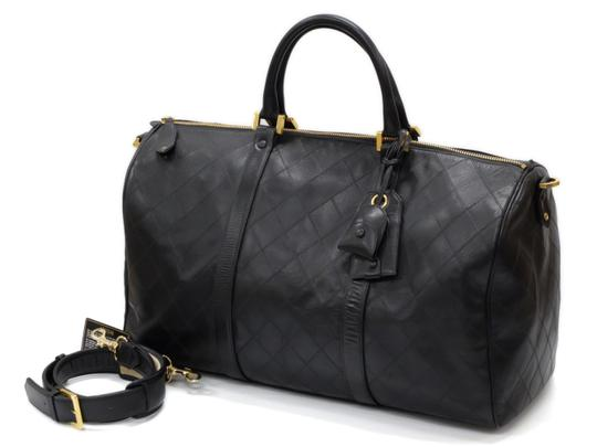 Preload https://img-static.tradesy.com/item/26023448/chanel-duffle-quilted-boston-with-strap-237782-black-lambskin-weekendtravel-bag-0-0-540-540.jpg