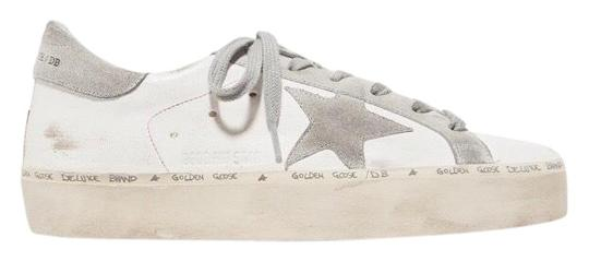 Preload https://img-static.tradesy.com/item/26023780/golden-goose-deluxe-brand-hi-star-distressed-leather-sneakers-size-eu-40-approx-us-10-regular-m-b-0-1-540-540.jpg
