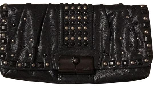 Preload https://img-static.tradesy.com/item/26024732/coach-15359-kristen-studded-black-textured-leather-clutch-0-1-540-540.jpg