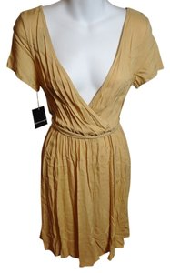 Apostrophe short dress Tan Short Sleeve Deep Front on Tradesy