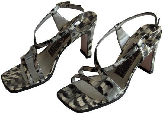 Preload https://img-static.tradesy.com/item/26025680/silver-and-black-new-strappy-blacksilver-patent-leather-sandals-size-us-7-regular-m-b-0-2-540-540.jpg