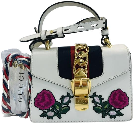 Preload https://img-static.tradesy.com/item/26025731/gucci-mini-sylvie-embroidered-white-leather-shoulder-bag-0-5-540-540.jpg