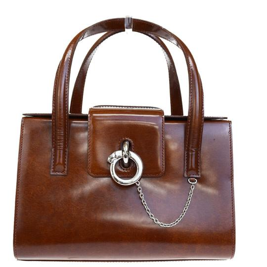 Preload https://img-static.tradesy.com/item/26031204/cartier-logos-panther-hand-patent-brown-leather-wristlet-0-0-540-540.jpg