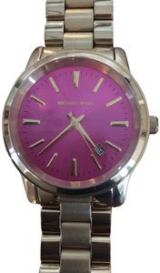 Michele Michele Gold tone watch with pink face