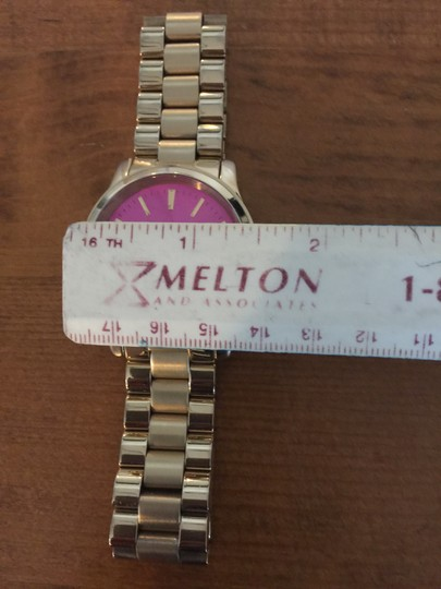 Michele Michele Gold tone watch with pink face Image 2