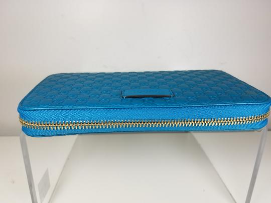 Gucci Women's 449391 Cobalt Leather Micro GG Guccissima Zip Around Wallet. Image 5